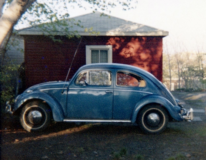 The 1957 VW. Note the antenna, hub caps, and whitewalls.
