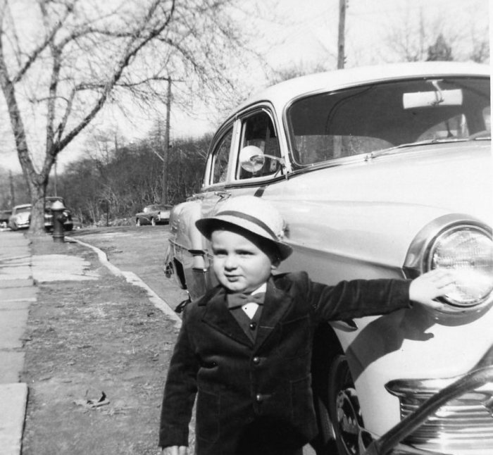 The author, age 2, with Dad's '53 Chevrolet. I had to touch the car.