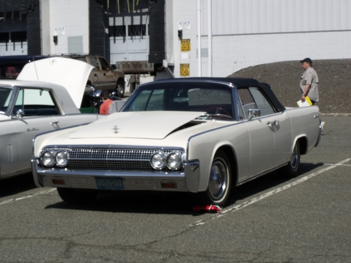 "Early '60s Lincoln Continental convertible, the last domestically-produced 4-door car with ""suicide"" rear doors."