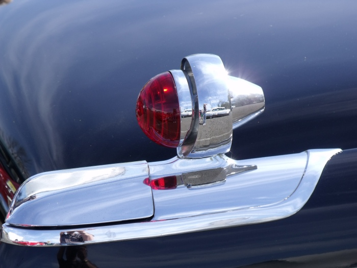 "The ""gunsight"" tail light of a 1955 Chrysler Imperial."