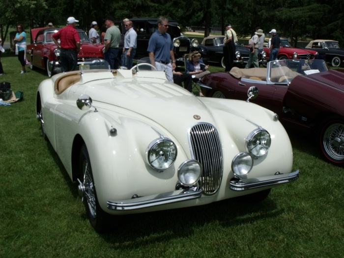 "An XK-120 MC. Note the ""wind visors"" in place of a proper windscreen."