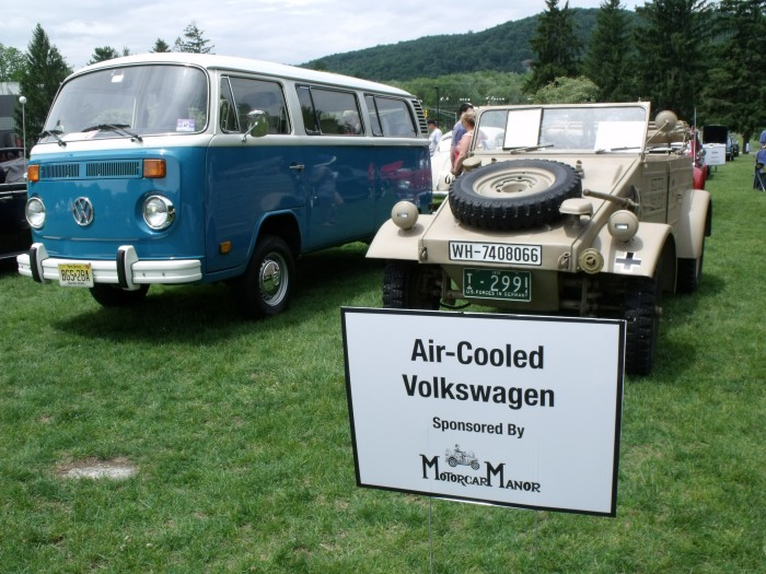 Two extremes of air-cooled VWs: a '70s bus next to a WW2 military VW.