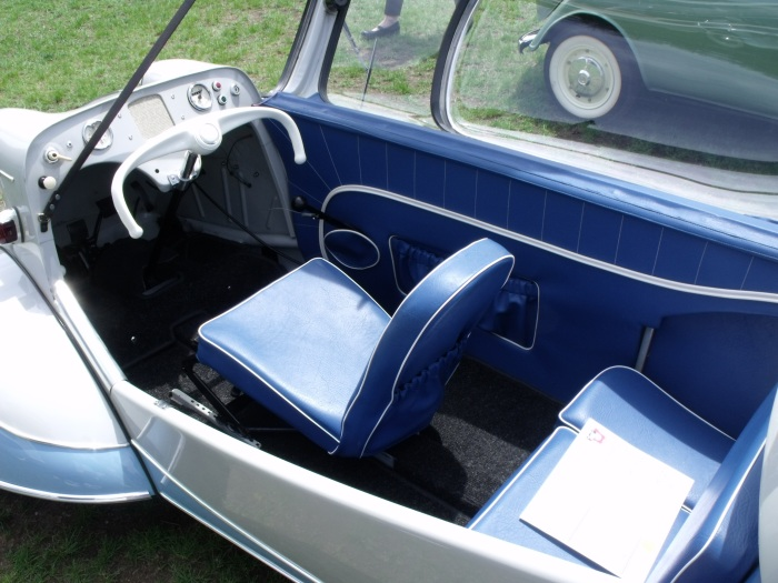 A 1955 Messerschmitt with its canopy top open.