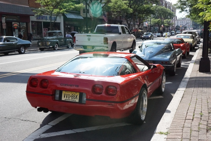 Three different generation Corvettes line up on Main St.