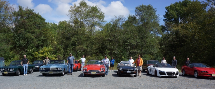 The group with their automobiles