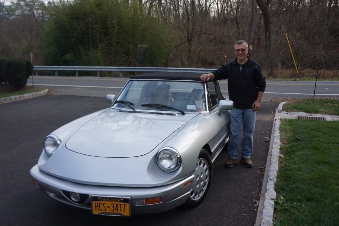 Proud new owner with his 1991 Alfa Romeo spider