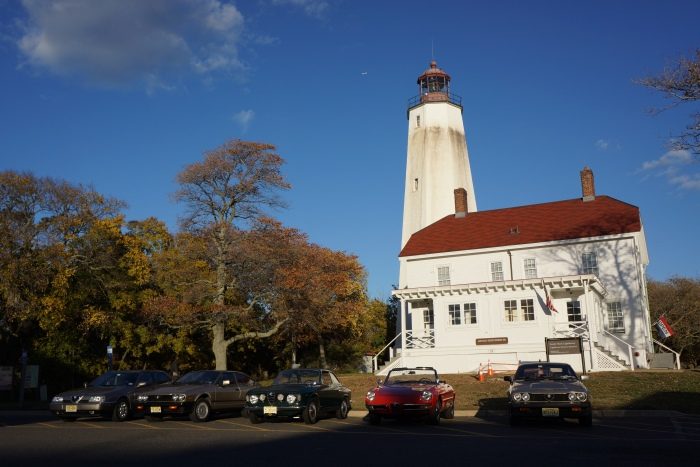 The Alfas line up in front of the Sandy Hook Lighthouse