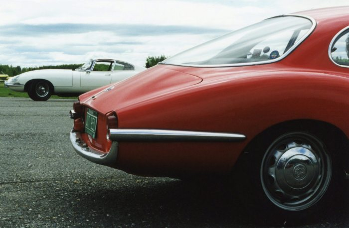 The E-Type poses behind the Sprint Speciale