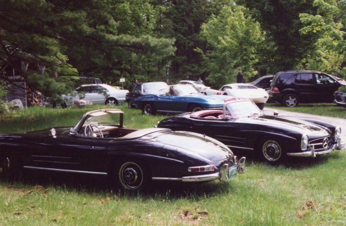 Two M-B 300SL roadsters sit it out